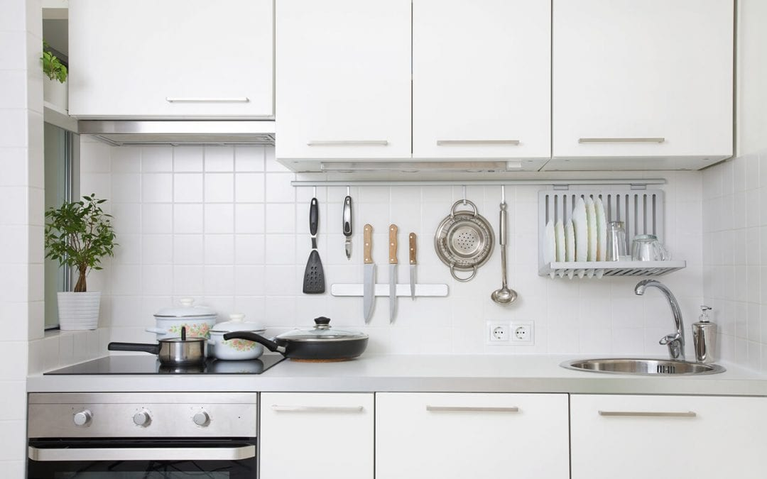 ideas for a small kitchen include a magnetic utensil bar